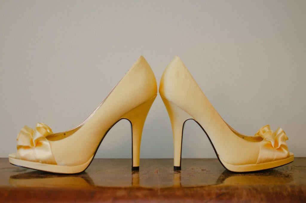 a pair of gold high heels