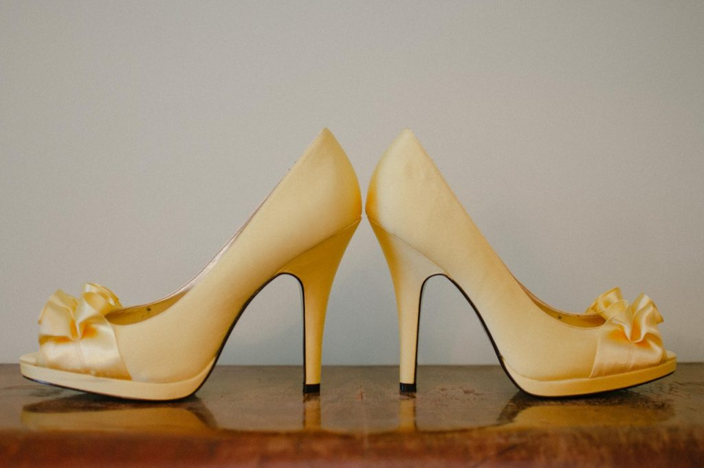 a pair of gold high heels